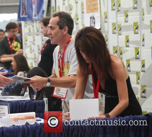 Signs autographs for fans at Comic Con.