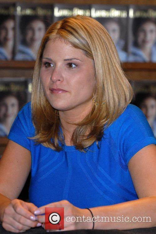 Jenna Bush Laura Bush signs copies of her...