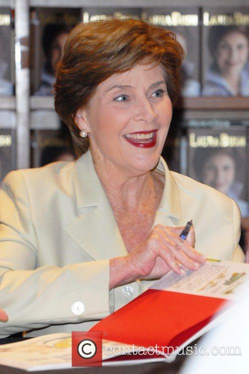 Laura Bush  signs copies of her memoir...