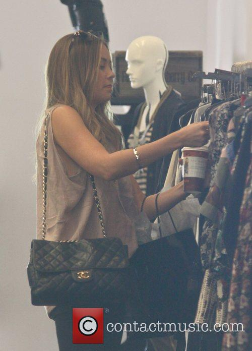 Is seen shopping while filming her new reality...