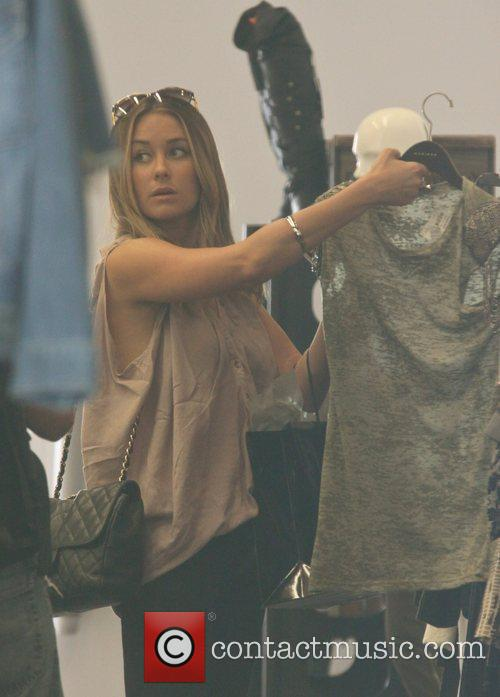 Lauren Conrad is seen shopping while filming her...