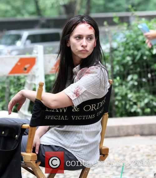 A bruised and bloodied Jennifer Love Hewitt appears...