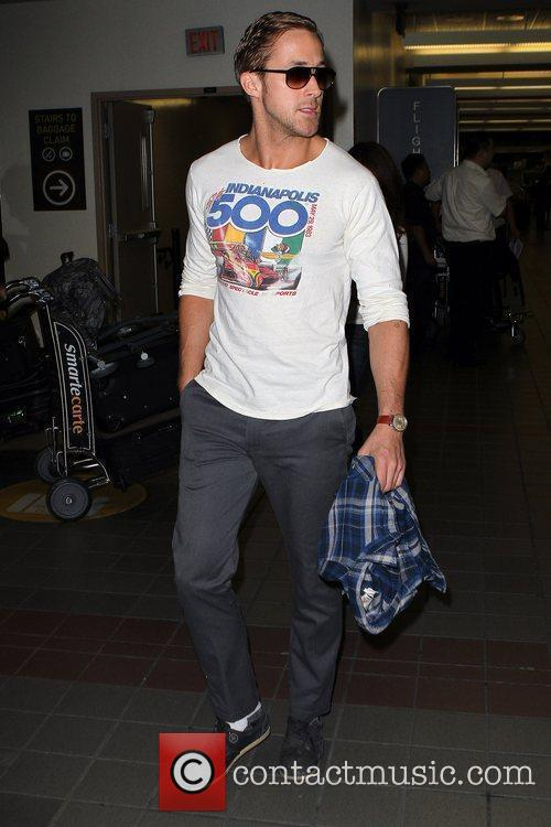 Ryan Gosling arriving at LAX airport sporting an...