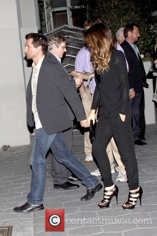 Holding hands while leaving ArcLight Cinemas Cinerama Dome...