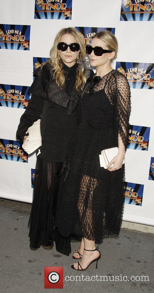 Mary-Kate Olsen and Ashley Olsen attending the opening...