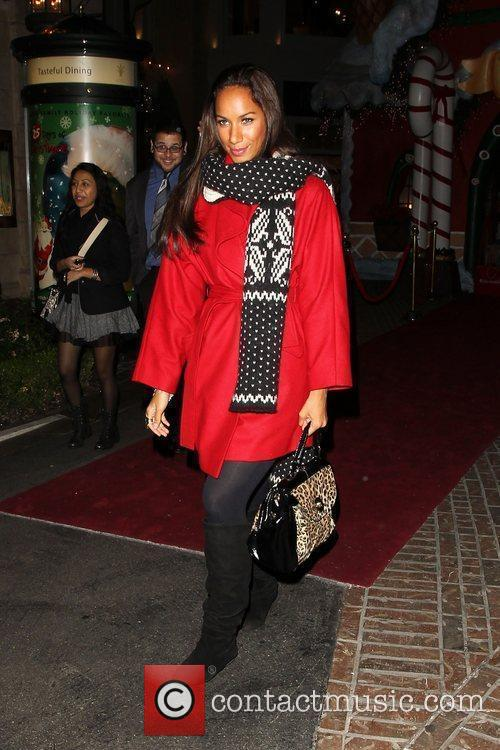 Leona Lewis in a bright scarlet winter coat,...