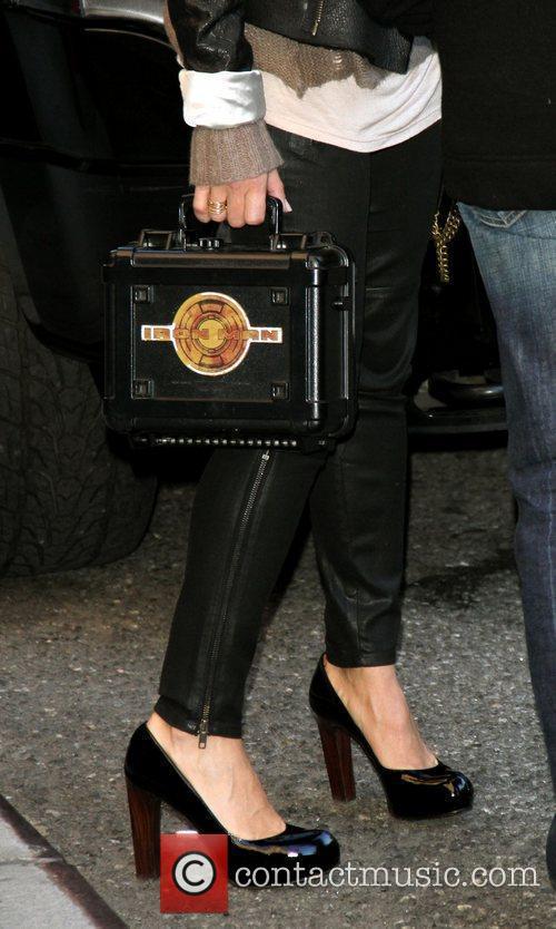 Susan Downey Jr carries a Iron Man lunch...