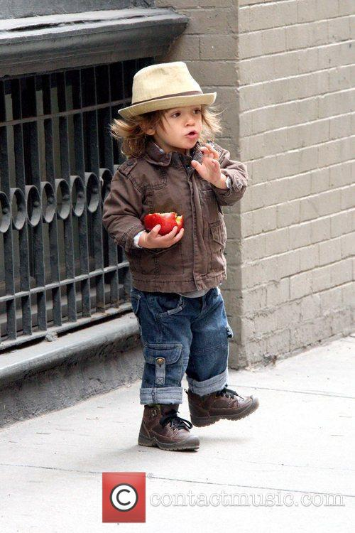 Eating an apple while walking in Soho with...