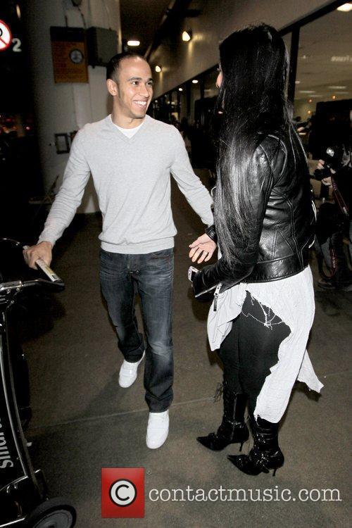 Nicole Scherzinger greets her boyfriend, Lewis Hamilton, at...