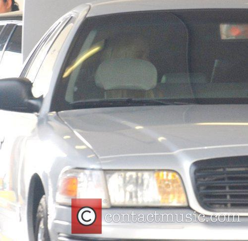Lindsay Lohan is seen inside her vehicle as...