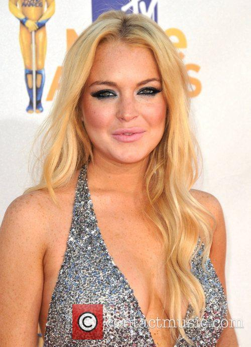 * LOHAN RELEASED FROM REHAB CENTRE EARLY LINDSAY...