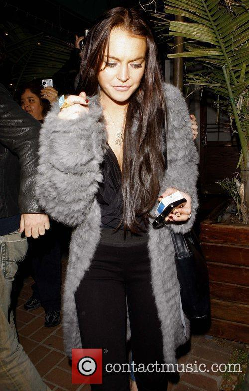 Arrives at Madeo restaurant in West Hollywood