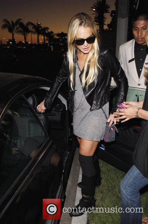 Lindsay Lohan heading to her car after catching...