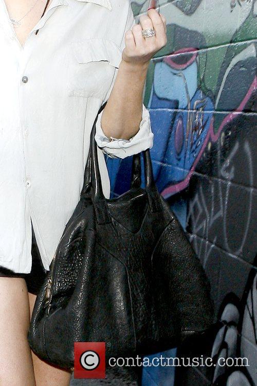 Lindsay Lohan's black handbag Lindsay Lohan leaves a...