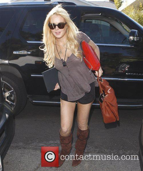 Lindsay Lohan arriving at a friends house in...