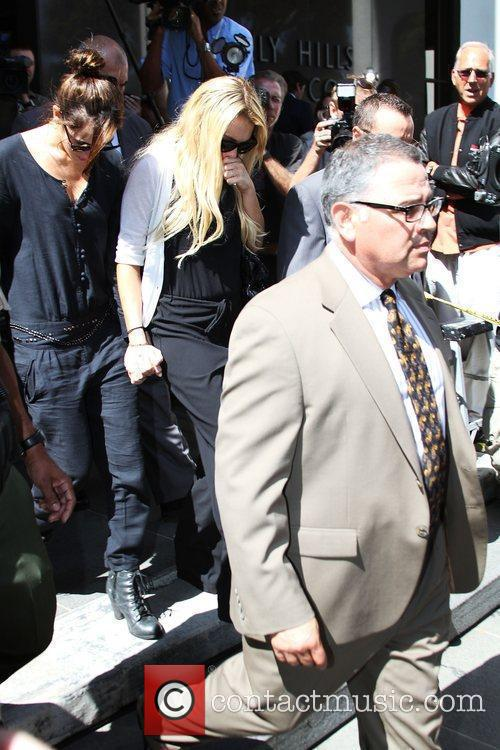 Leaving the Beverly Hills Courthouse after attending a...