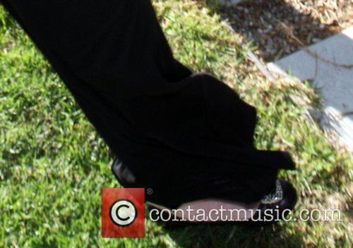 Lindsay Lohan  wears loose pants to cover...