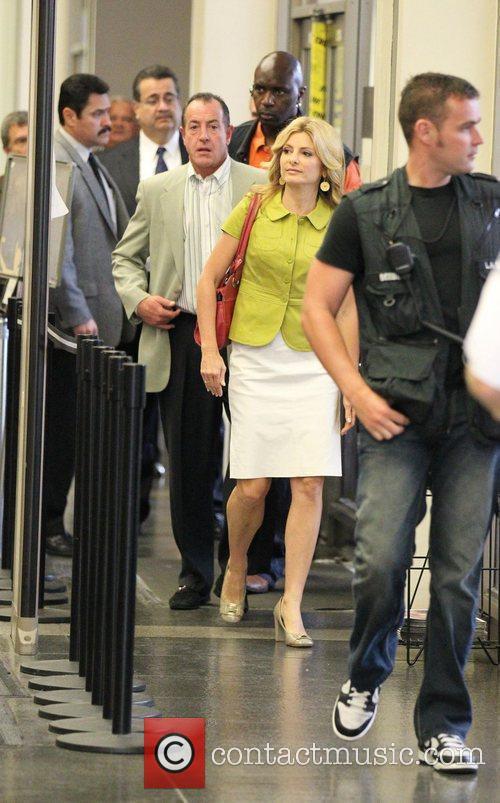Michael Lohan  passes through the metal detector...