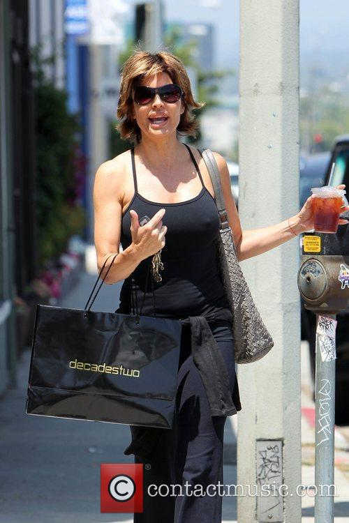 Departs a pilates studio on Melrose Avenue