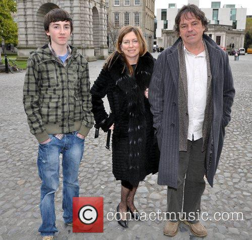 Neil Jordan with wife Brenda Rawn and son...