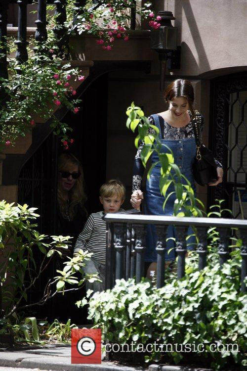 Leaves her Manhattan apartment along with her mother...
