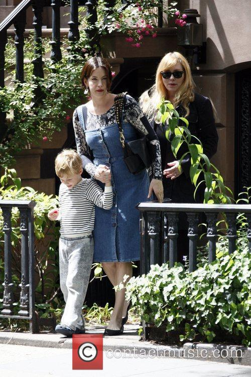 Liv Tyler leaves her Manhattan apartment along with...