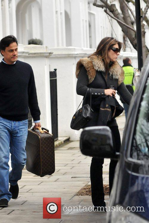 Elizabeth Hurley  with husband Arun Nayar carrying...