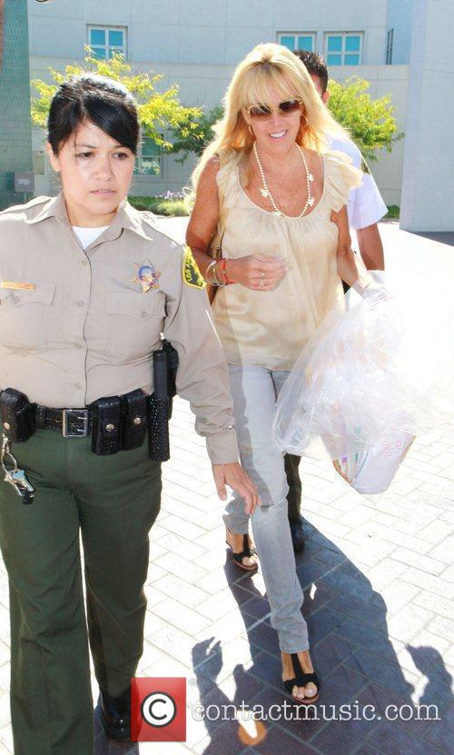 Leaves Lynwood Correctional Facility after visiting her daughter...