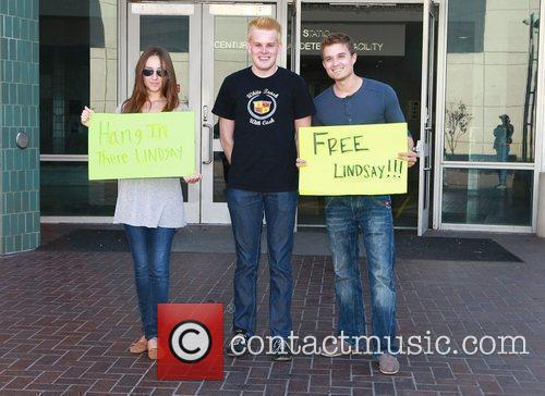 Protesters with placards wanting to free Lindsay Lohan...