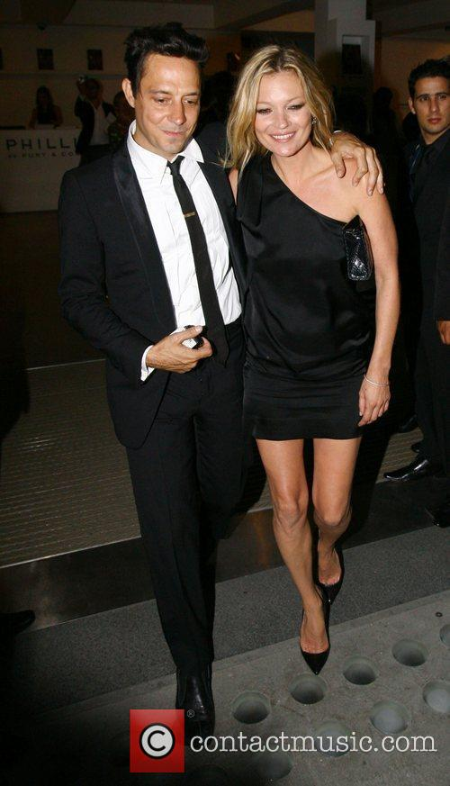 Jamie Hince and Kate Moss leaving a photo...