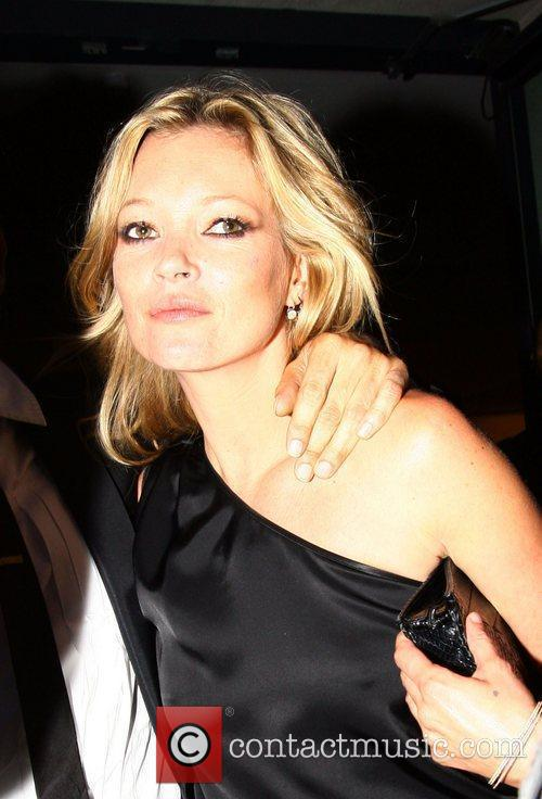 Kate Moss leaving a photo exhibition launch by...