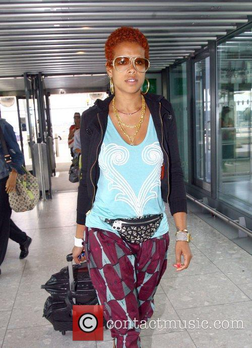 Kelis arriving at London's Heathrow Airport for a...