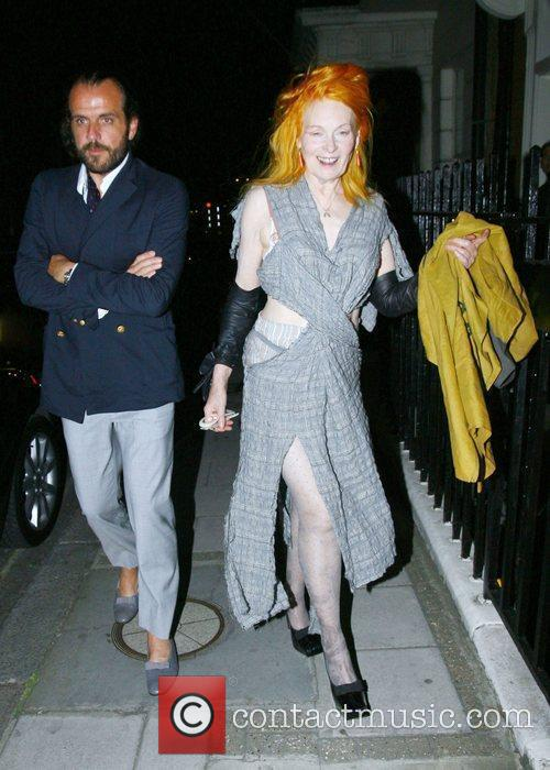 Vivienne Westwood and a male companion leaving a...