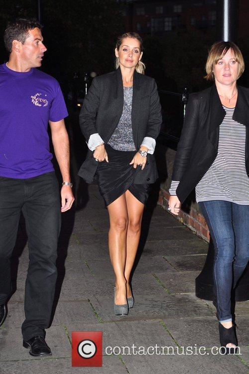 Arrives at Dukes 32 where she is hosting...