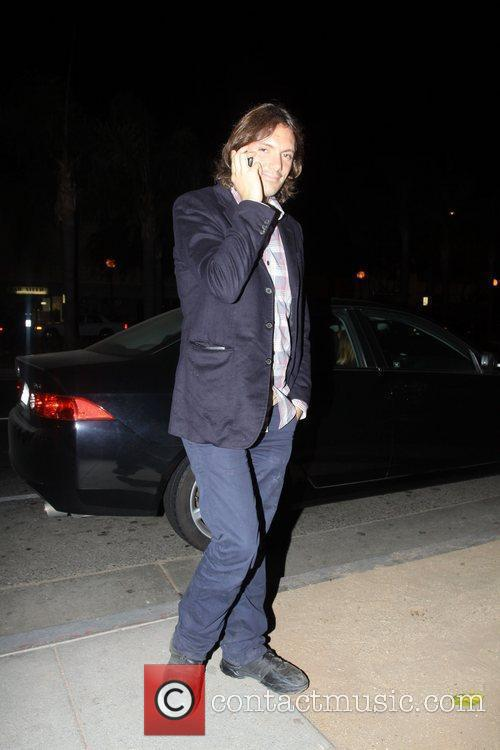 Talking on the phone while out in Hollywood.