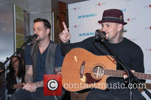 Benji and Joel Madden of Good Charlotte perform...