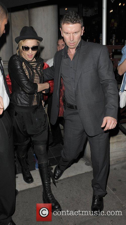 Madonna is escorted out of Aura nightclub by...