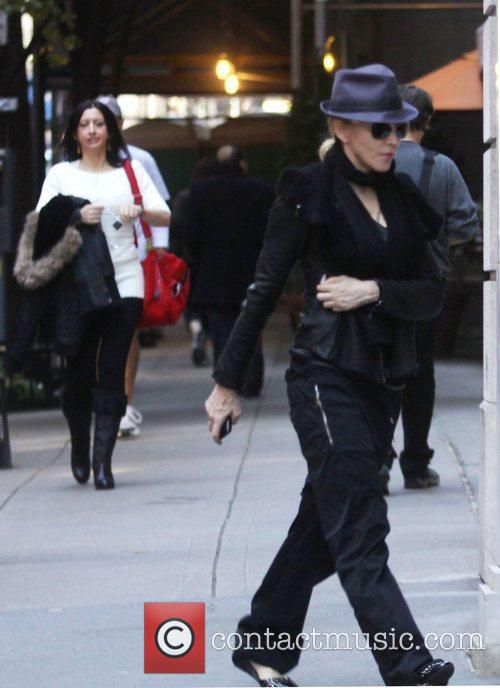 Madonna and her family are seen arriving at...