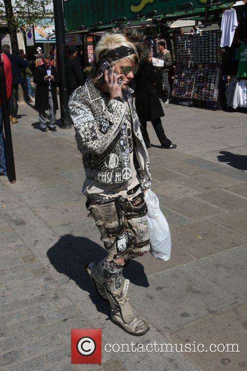 Mourners dressed in punk fashions turn out to...