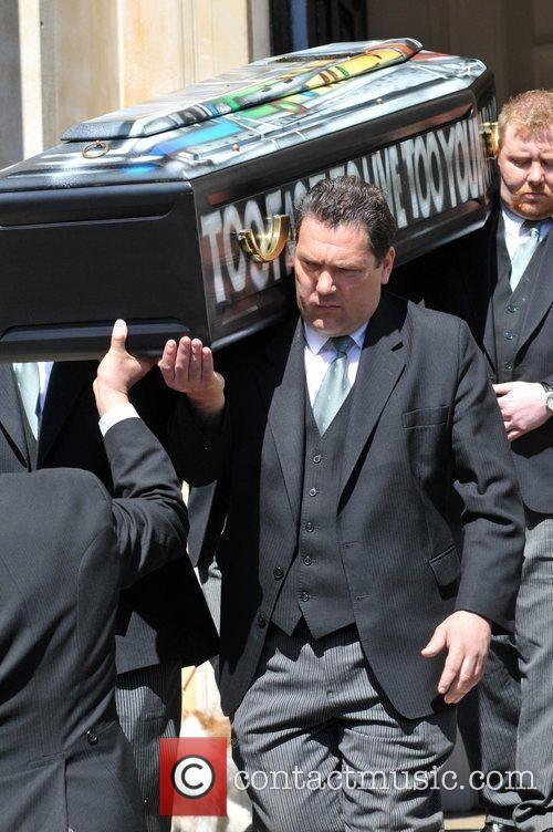 Pallbearers carry Malcom Mclaren's coffin from the Holy...
