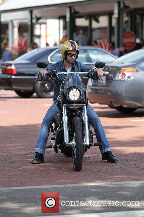 Out and about on his motorcycle at Malibu...