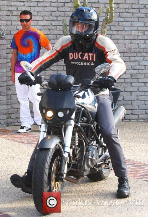 Adrien Brody on his Ducati motorcycle Celebrities attend...