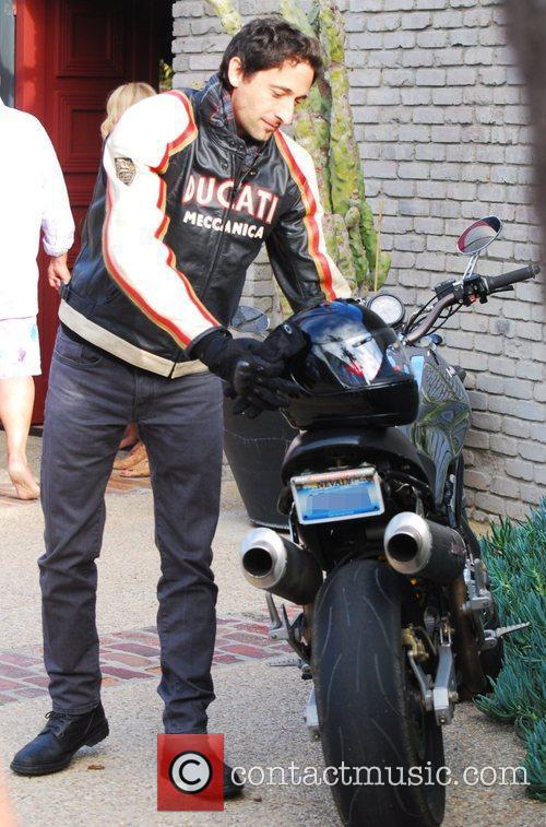 Adrien Brody and his Ducati motorcycle Celebrities attend...