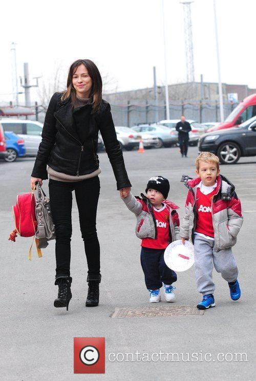 Anna Vidic and her children arrive at Manchester...