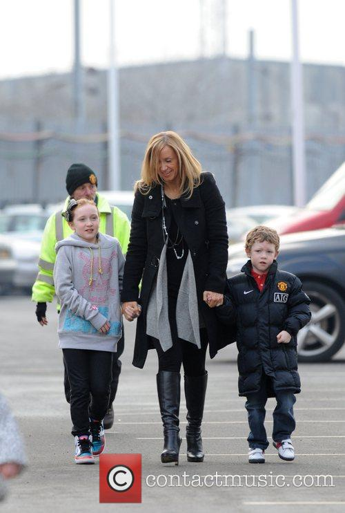 Claire Scholes and her children arrive at Manchester...