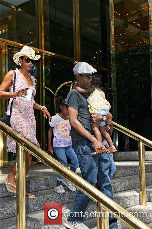 Chris Rock leaves his Manhattan Hotel with his...