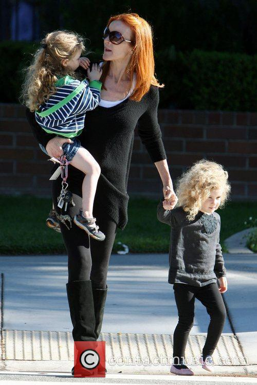 Out and about with her daughters Eden and...