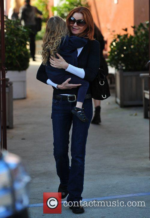 Is seen spending time with her husband Tom...