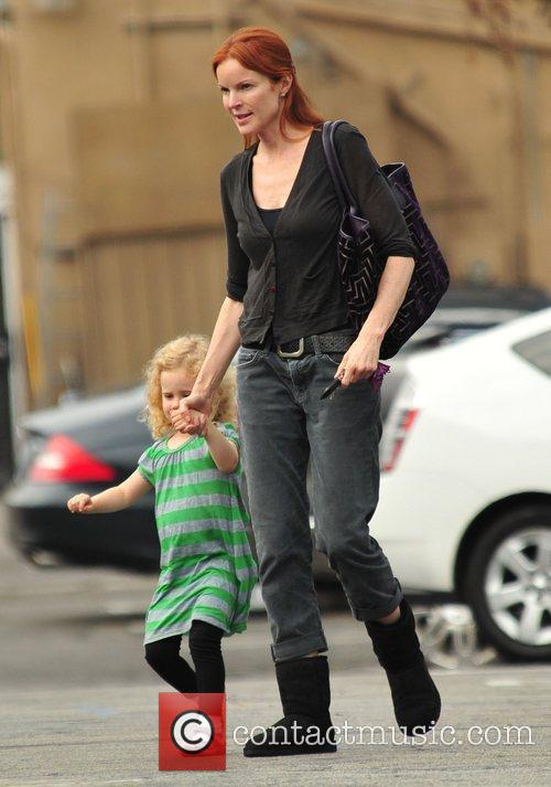 Marcia Cross and her daughter leave The Brentwood...