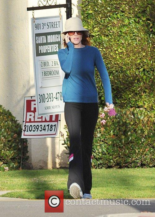 Marcia Cross goes for a power walk whilst...